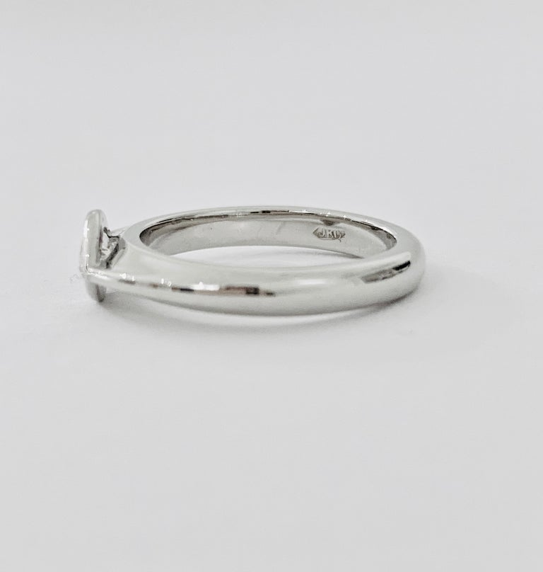 The very modern and sleek design band of platinum is made up with a .75ct marquise diamond set in an east to west design.  The ring would make both an amazing 'talking piece' for an engagement ring as well as a very wearable day ring for the right