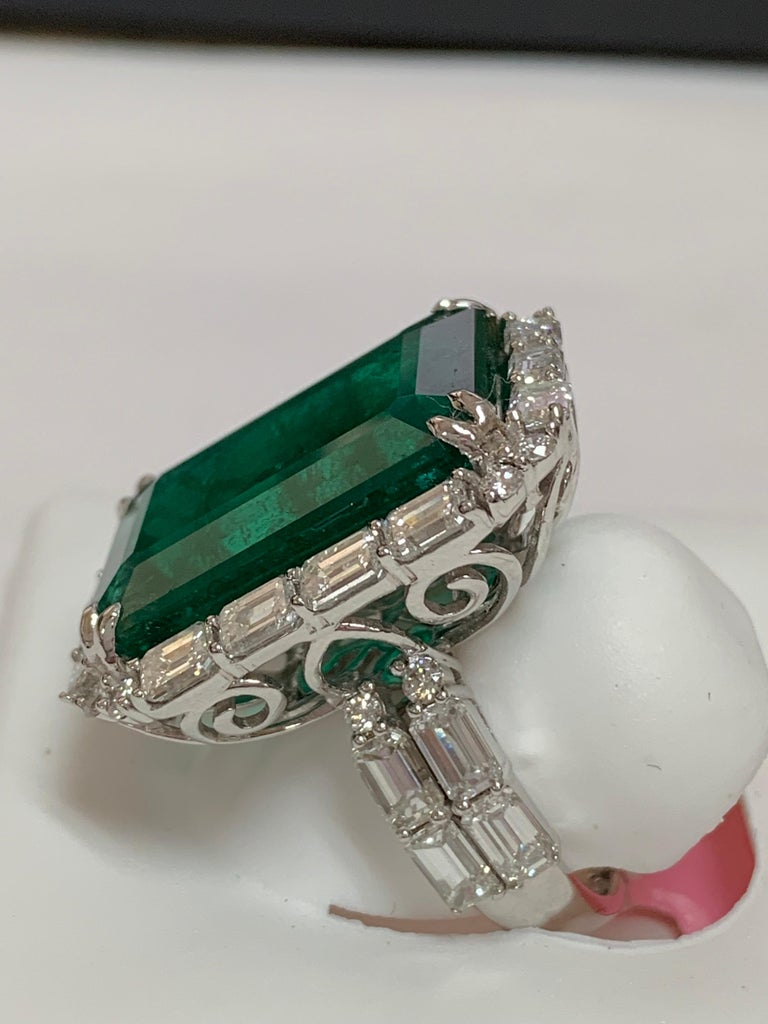 Contemporary IGLCertified 23.98 Carat Emerald and a Diamond Ring For Sale