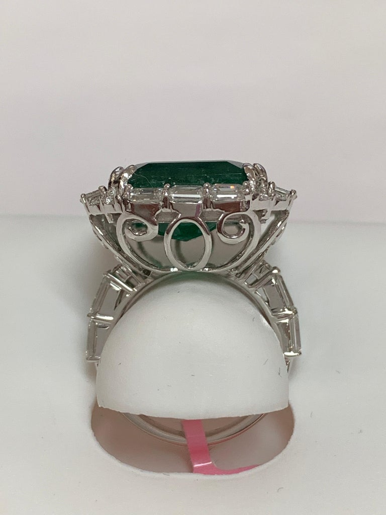 Emerald Cut IGLCertified 23.98 Carat Emerald and a Diamond Ring For Sale