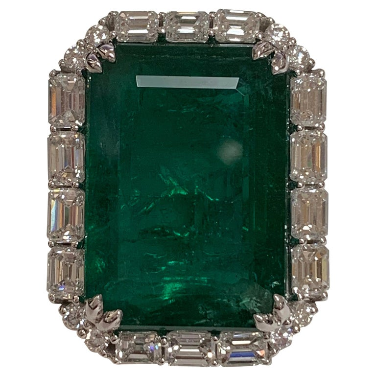 IGLCertified 23.98 Carat Emerald and a Diamond Ring For Sale