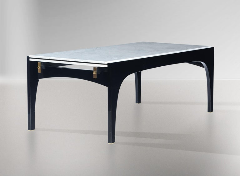 An exceptional and rare extendable dining table designed by Ignazio Gardella for Misura Emme, Italy, circa 1985. This impressive rectangular table is black lacquered with brass detailing and has an amazingly engineered system for extending the