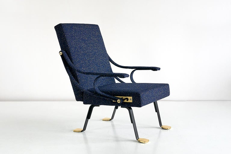 Designed by Ignazio Gardella in 1957, the Digamma lounge chair is a comfortable chair with roots in the late Italian modernist tradition. Its rational construction features two geometric sections, the rectangular upholstered back and seat, bound by