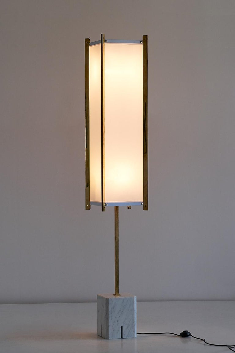 This rare model LTE 12 Prisma floor lamp was designed by Ignazio Gardella and manufactured by Azucena in the early 1960s. The base of the lamp is in solid white Carrara marble, the stem and trims of the shade are in polished brass. The rectangular