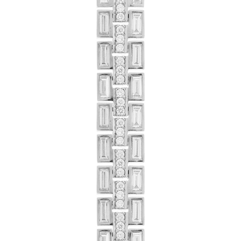 Handcrafted from polished 18k white gold, this exquisite piece features two rows of sparkling white diamond baguettes separated by a glimmering row of pave round white diamonds.      Polished 18k white gold     Total Length: 17.5 cm
