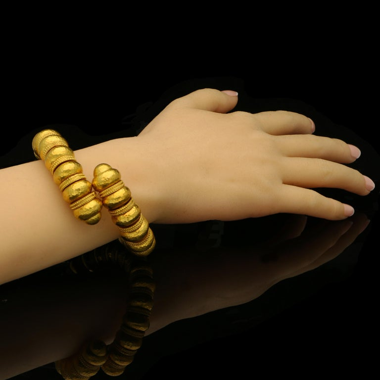 """22ct yellow gold signed Ilias Lalaounis and with maker's mark and K22 Inside wrist circumference 6.5"""" 129 grams  A stylish gold bead bracelet from the Minoan and Mycenaean collection by Ilias Lalaounis c.1970s, the open sprung bracelet designed as a"""