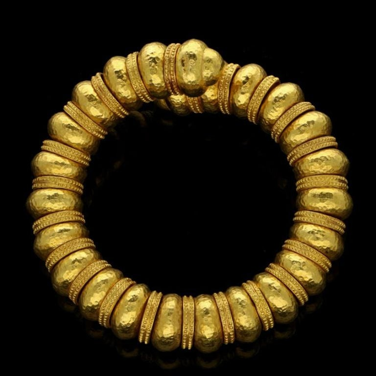 Hellenistic Ilias Lalaounis Gold Bead Open Sprung with Hammered Finish and Textured Bracelet For Sale