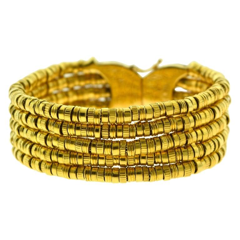 Ilias Lalaounis Helen of Troy Textured Flexible 18 Karat Yellow Gold Bracelet For Sale