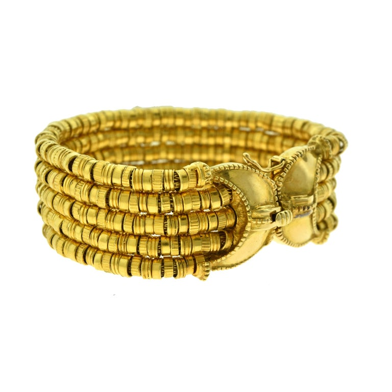 Brilliance Jewels, Miami Questions? Call Us Anytime! 786,482,8100  Designer: ILIAS LALAOUNIS  Collection: Helen of Troy  Style: Textured Bracelet   Metal: Yellow  Gold  Metal Purity: 18k  Bracelet Length:  7 inches   Bracelet Width: