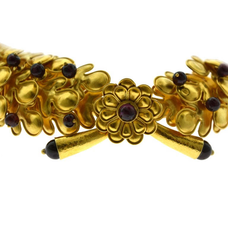 Brilliance Jewels, Miami Questions? Call Us Anytime! 786,482,8100  Designer: Ilias Lalaounis  Style: Large Choker (can be worn as a head Tiara)  Metal: Yellow Gold   Metal Purity: 18k   Stone: 49 Cabochon Rubies  Total Item Weight (grams):