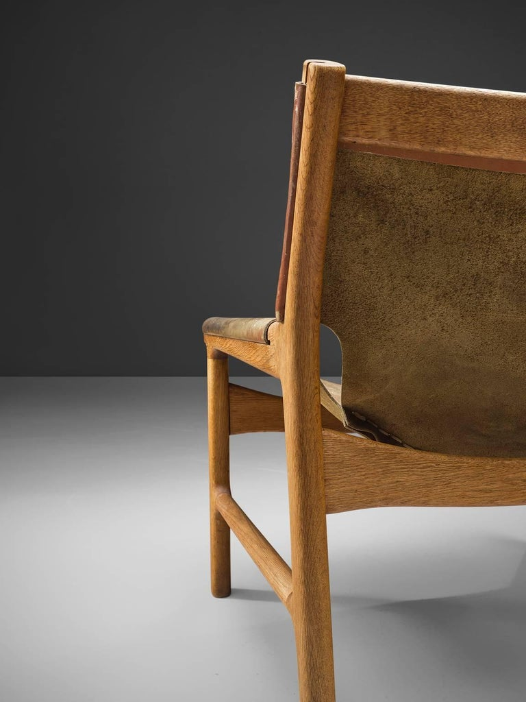 Illum Wikkelsø Easy Chair in Oak and Leather In Good Condition For Sale In Waalwijk, NL