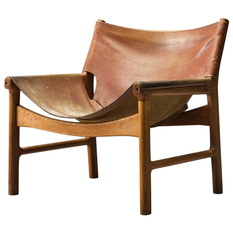Illum Wikkelsø Easy Chair in Oak and Leather For Sale