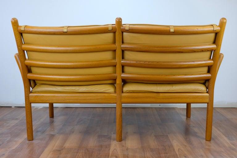 Scandinavian Modern Illum Wikkelsø 'Genius' Loveseat in Leather and Teak For Sale