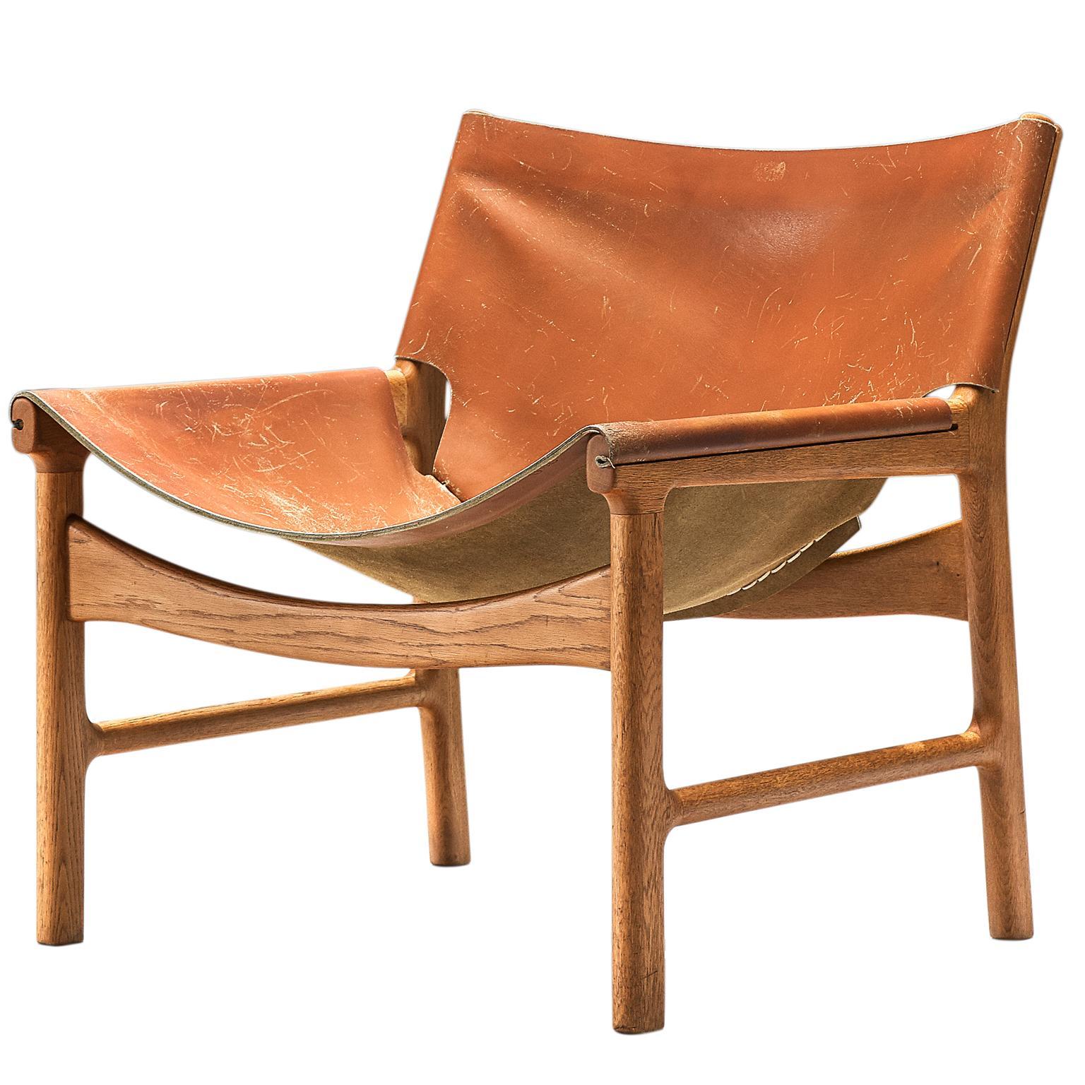 Illum Wikkelsø Lounge Chair in Cognac Leather and Oak