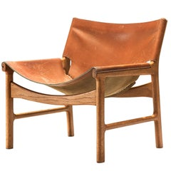 Illum Wikkelsø Lounge Chair in Cognac Leather and Oak