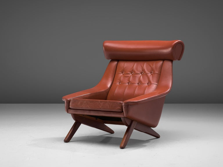 Illum Wikkelsø, lounge chair 'Ox', red leatherette, wood, Denmark, 1960s  Due to the prominent horizontal headrest this lounge chair by Illum Wikkelsø is nicknamed 'Ox'. In a way it also visually refers to Hans J. Wegner's 'Ox' chair (1960). This