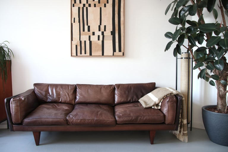 """This freestanding sofa, better known as """"Model V11"""" is considered among the masterpiece designs of Illum Wikkelsø. The Danish designer created the """"V11"""" series in 1965 whilst working with master cabinetmaker Holger Christiansen in Aarhus,"""