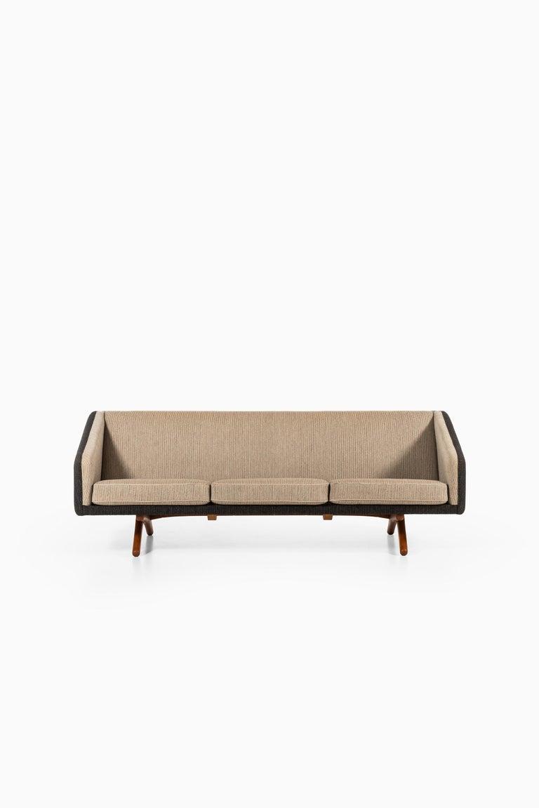 Rare sofa designed by Illum Wikkelsø. Produced by Michael Laursen in Denmark.