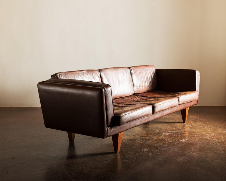 A nice example of the rare sculptural V11 by Illum Wikkelso. In brown leather with nice patina. Designed for Holger Christiansen, Denmark, 1960s.