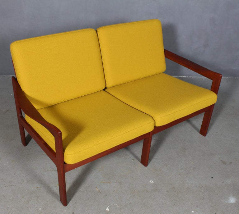 Illum Wikkelsæ two seat sofa with frame of teak. Sculptural armrests.  Cushions new upholstered with Halllingdal wool from Kvadrat.  Model 20, made by N. Eilersen.