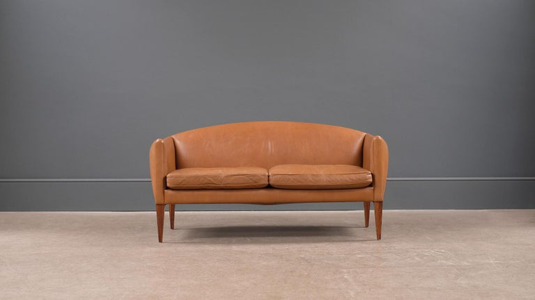 Wonderful super rare small sofa / loveseat designed by Illum Wikkelso for cabinetmaker Holger Christiansen, Denmark. Beautiful proportions, super elegant and very comfortable.