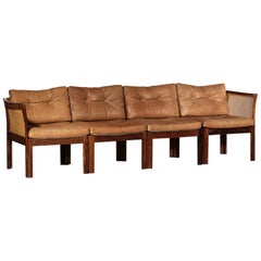 Illum Wikkelso Leather Sofa in Rosewood and Woven Rattan Cane