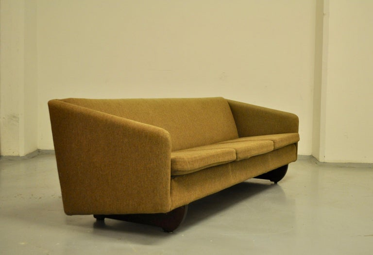 Danish sofa designed by Illum Wikkelso wearing its original fabric. Its beech base responds to a customer's special order and makes it even more rare.