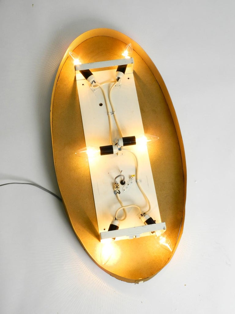 Illuminated Oval 1960s Large Wall Mirror with a Brass Frame For Sale 3
