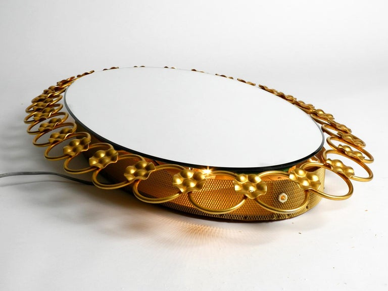 Illuminated Oval 1960s Large Wall Mirror with a Brass Frame For Sale 4
