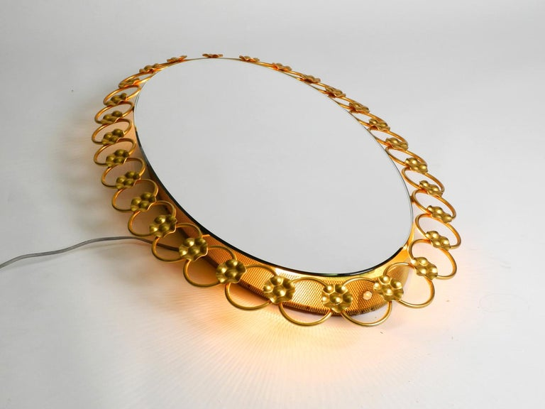 German Illuminated Oval 1960s Large Wall Mirror with a Brass Frame For Sale