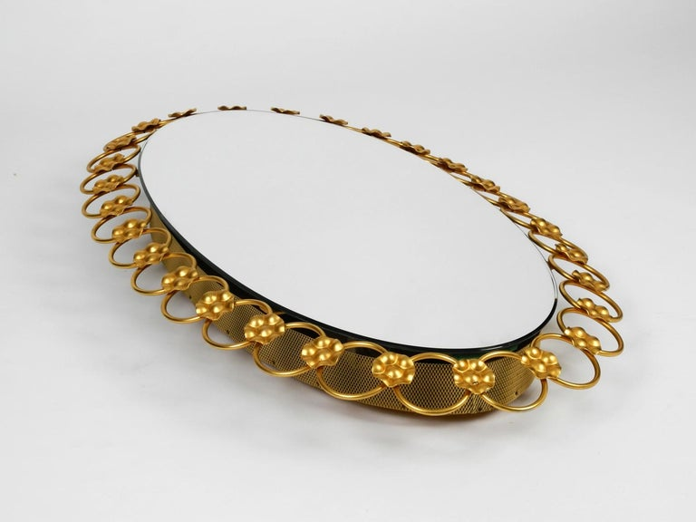 Illuminated Oval 1960s Large Wall Mirror with a Brass Frame In Good Condition For Sale In München, DE