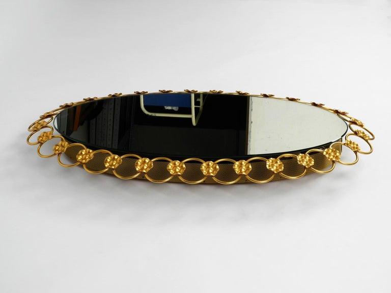 Metal Illuminated Oval 1960s Large Wall Mirror with a Brass Frame For Sale