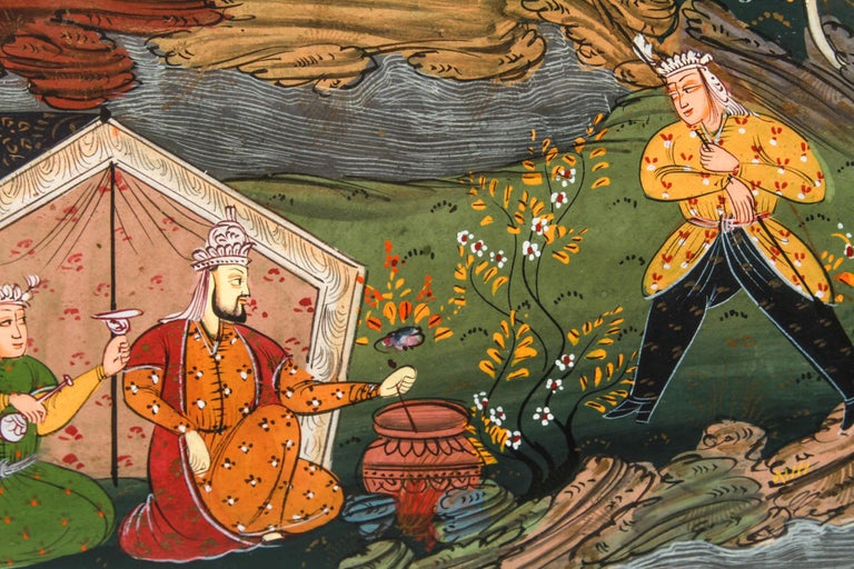 Illuminated framed Persian hand painted manuscript miniature depicting a scene from the epic poem of the Shahnameh, the Book of Kings, with a young man eavesdropping on two men sitting among trees.
