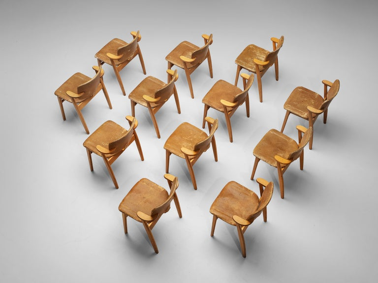 Ilmari Tapiovaara, armchairs model 'Domus', beech, leather, Finland, design 1953  Early 'Domus' armchairs by Ilmari Tapiovaara. The frame is made from solid beech wood and the seat and backrest are upholstered in a patinated leather This model was