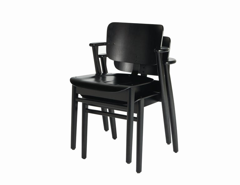Ilmari Tapiovaara Domus chair in black birch and leather for Artek. Designed in 1946 and produced by Artek of Finland. Executed in black stained birchwood and black prestige leather on seat and back. Stackable up to four chairs. 