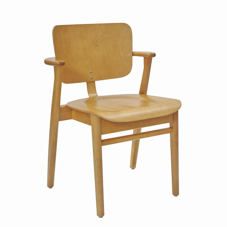 Ilmari Tapiovaara Domus chair in Honey Stained Birch for Artek. Designed in 1946 and produced by Artek of Finland. Executed in honey stained birch wood. Stackable up to four chairs.   Price is per item. New in box with