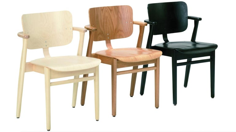 """Ilmari Tapiovaara Domus chair in natural oak for Artek. Designed in 1946 and produced by Artek of Finland. Executed in natural lacquered oak wood. Stackable up to four chairs.   Price is per item. New in box with """"Certificate of Authenticity""""."""