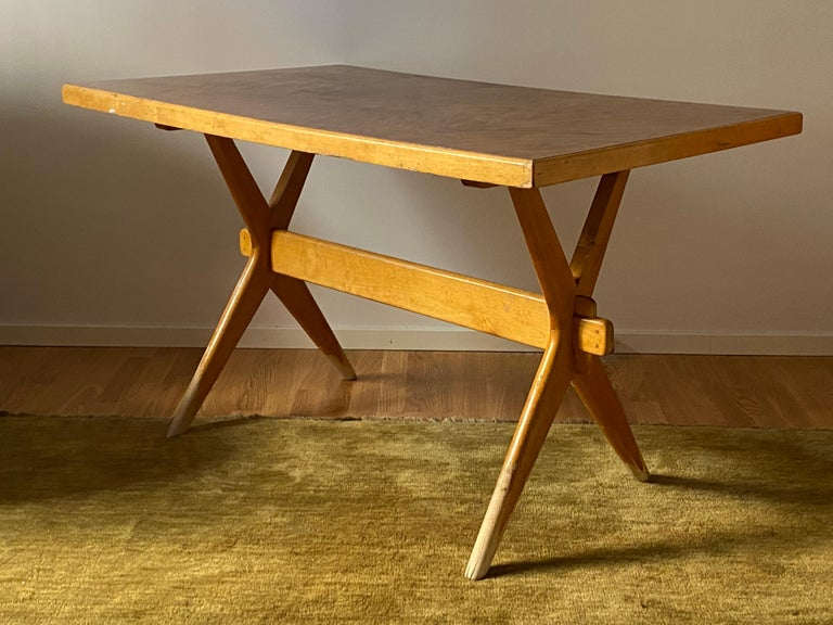 A rare and early functionalist desk or writing table, or console table. Designed by Ilmari Tapiovaara. Produced by Laukaan Puu, Finland, 1950s. Finely sculpted light birch, contrasting medium brown top.   As with Pierre Jeanneret and Charlotte