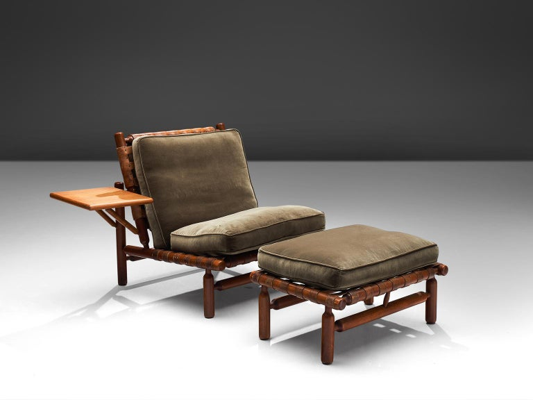 Ilmari Tapiovaara for Esposizione La Permanente Mobili, lounge chair and ottoman, teak and leather, Italy, 1957.   This rare set with chair and ottoman are designed by the Finnish designer Ilmari Tapiovaara. This organic design features beautiful