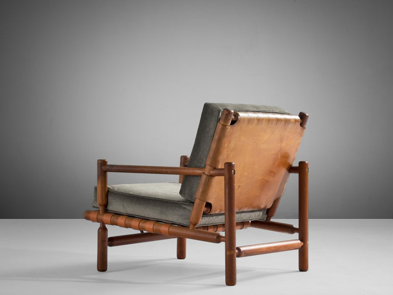 Ilmari Tapiovaara, lounge chair, teak, fabric, leather, Italy, 1957.  Rare lounge chair designed by Ilmari Tapiovaara, made of beautiful supple leather accompanying a solid teak frame. The design was produced in 1957 by the artisan workshop