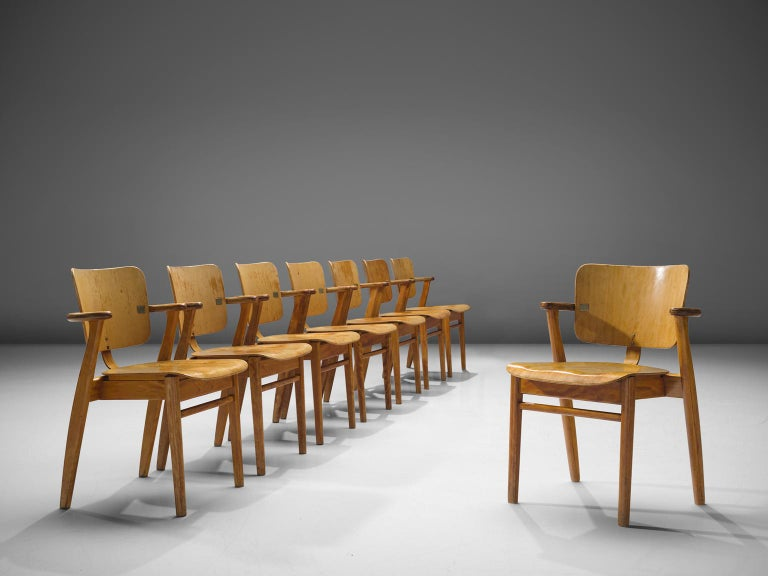 Ilmari Tapiovaara, set of eight 'Domus' armchairs, in birch and brass colored metal, Finland, 1953. 