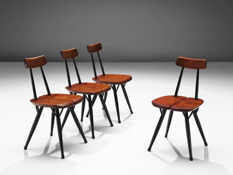 Ilmari Tapiovaara for Laukaan Puu, Pirkka dining chairs, beech, pine, Finland, 1950s.  This set of chairs is designed by Ilmari Tapiovaara. This set was manufactured in the late 1950s. The Pirkka range was designed by Ilmari Tapiovaara as a