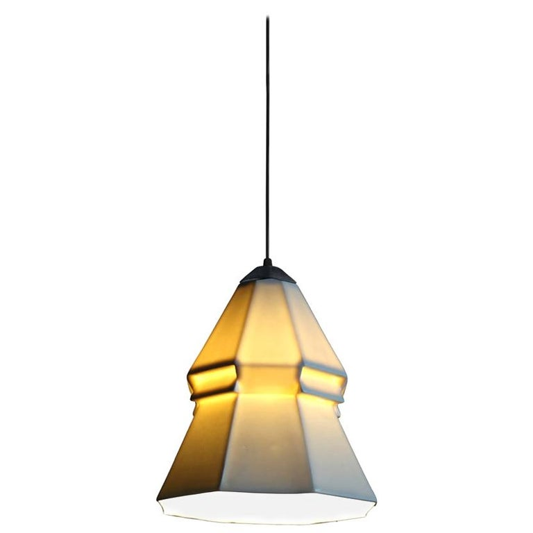 9 inch hanging pendant light from the Expansion collection, this pendant spreads white, direct light downward while the shade emits a soft, warm glow at eye level. It offers a subtle yet striking geometric detail, taking this porcelain design to the