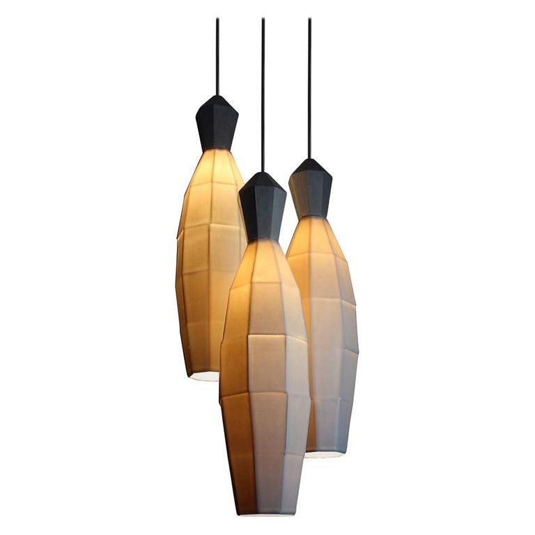Make the brightest statement with three of the largest geometric translucent porcelain pendants from the Extension collection. Arrange the large clustered hanging pendant lamps to your measurement specifications to bring modern, ambient lighting