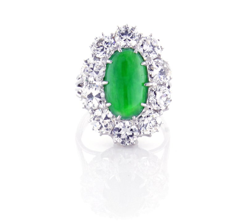 A rich green semi-translucent  cabochon Jadeite Jade cabochon. The type A jade is natural color wit no indication of treatments or impregnation.  ♦ Metal: Platinum 14 karat ♦ Gem stone:Jade= 4.83 carats 13.34*7.15*5.19 ♦ Gem stone: 10 Diamond=5