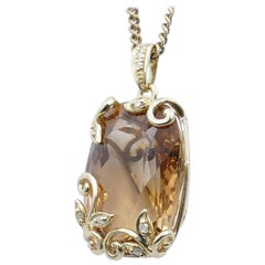 Imperial Topaz Pendant of 37 Carat in Yellow Gold