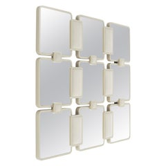Impeto Mirror with Glossy Lacquered Frame and Upholstered Panels