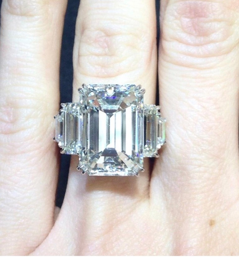 13.50 Carat Emerald Cut, J in Color VS2 in Clarity. Set with 3.00 carats of diamonds on the side. GIA Certified The diamond looks like 20 carats.