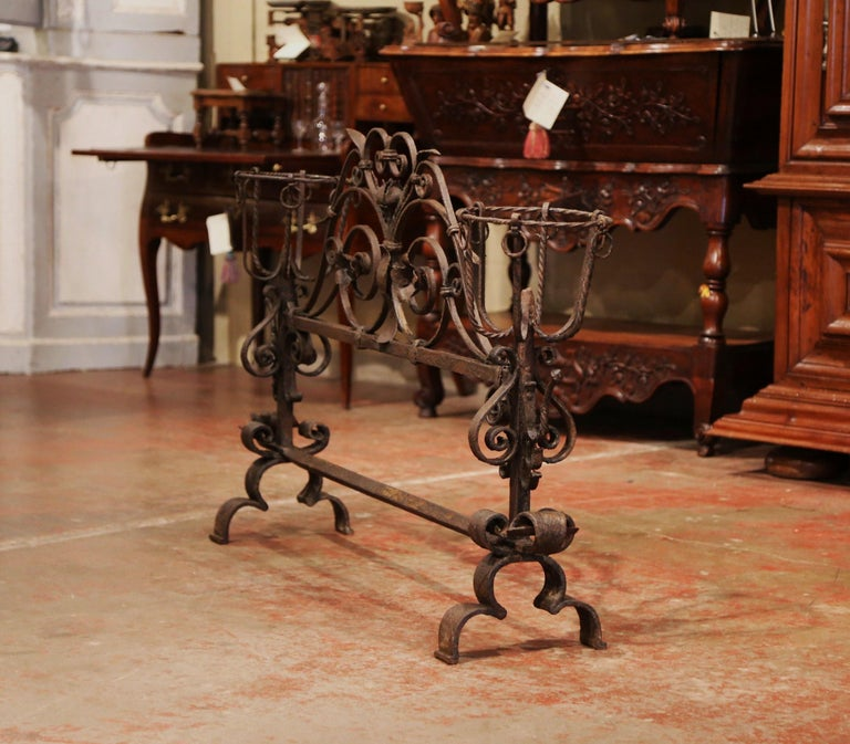 Decorate a fireplace hearth with this impressive, ornate iron screen. Forged in France circa 1760, the important, freestanding, decorative wrought iron piece features heavy iron scroll work with floral and leaf decor. The antique screen is further