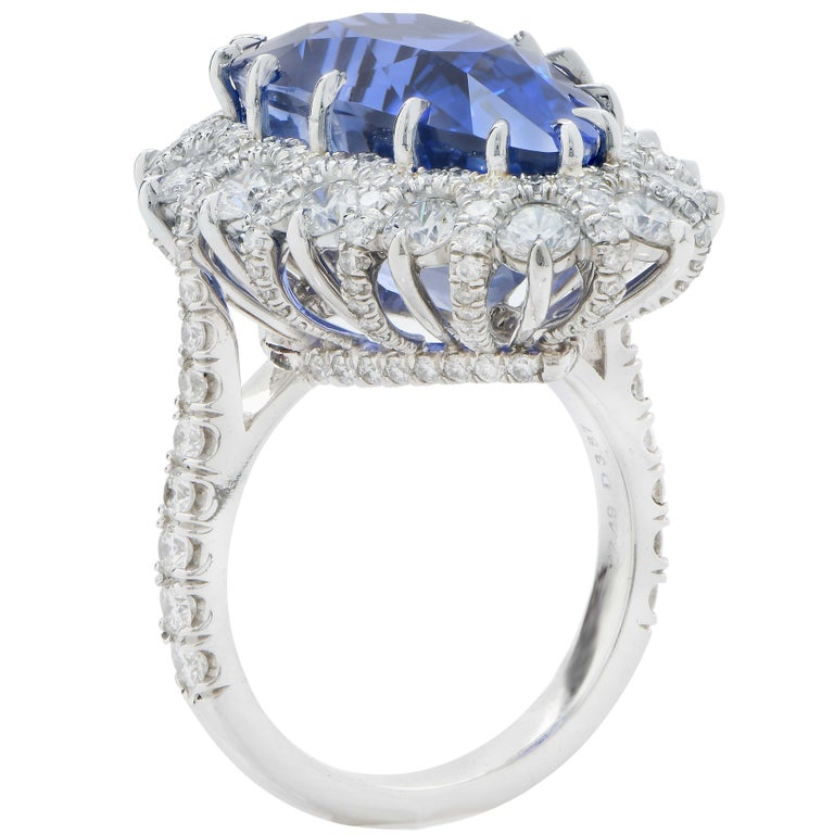 Important hand made platinum diamond ring features a 19 carat AGL Graded Ceylon No Heat pear shaped sapphire surrounded by 3.87 carats of round brilliant cut diamonds. This one of a kind hand made ring is size six and one half. It can be sized