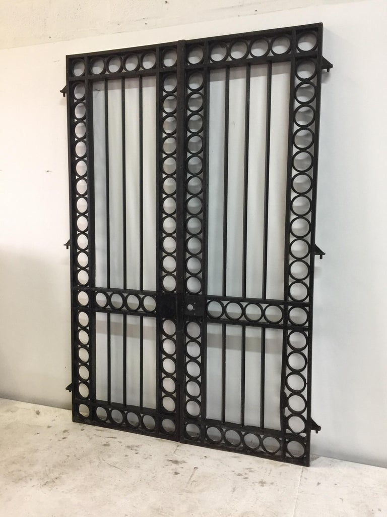 Pair of incredible iron entrance gates from the South of France, circa 19th century. From the estate of the Late Amy Perlin, a well known collector of antiques from around the globe. Similar designs attributed to Jean Royere. These gates are
